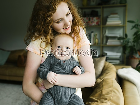 mother holding baby boy 6 11