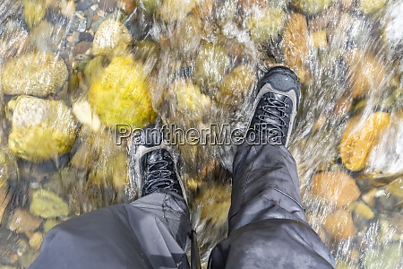 man standing in river