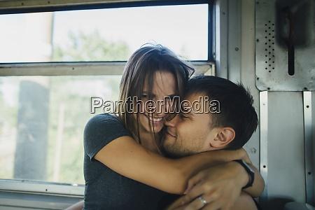 couple embracing on train