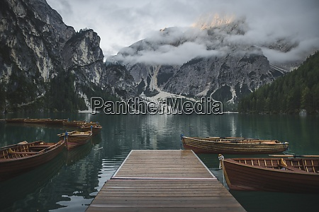 italy wooden boats moored by pier