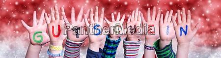 children hands gutschein means voucher red
