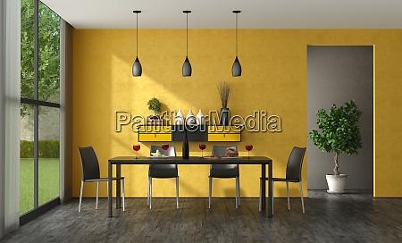 black and yellow minimalist dining room