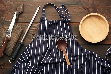 blue textile kitchen apron with white