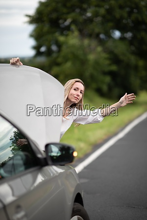 pretty middle aged woman having car