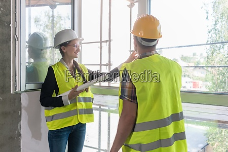 construction workers inspecting windows on site