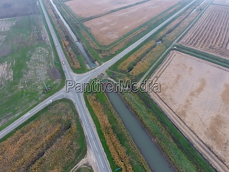 crossroads paved roads through the fields