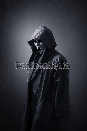 scary figure with mask in hooded