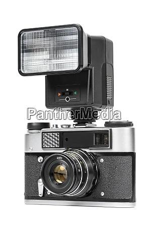 vintage analog camera with manual flash