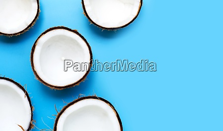 half coconut on a blue background