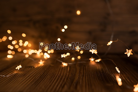 christmas lights on dark wood