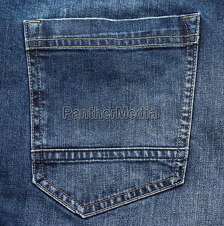 back pocket of blue jeans full