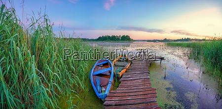 boats at sunrise on a lake