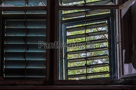 window with wooden sun protection