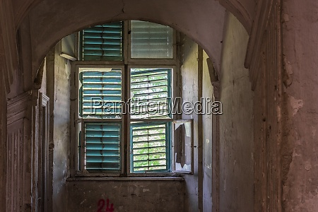 window with wooden sun protection in