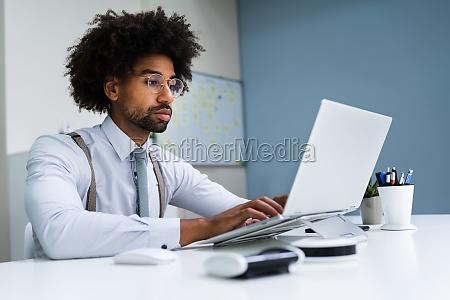 african american business man using laptop