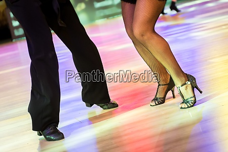 legs of a couple dancing latin
