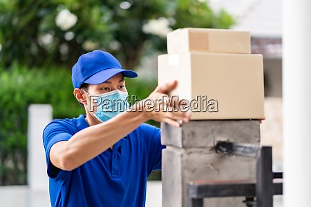 asian deliver man make contactless package