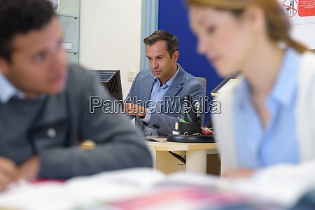 teacher in business technology classroom