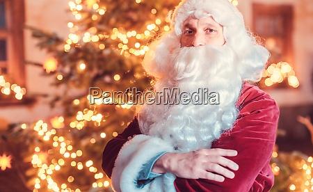 santa claus posing in front of