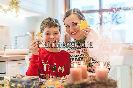 boy and his mother with christmas