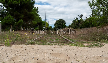 abandoned railroad track with sand