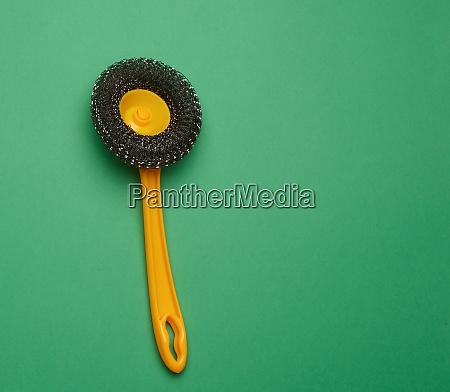 yellow plastic brush for cleaning the