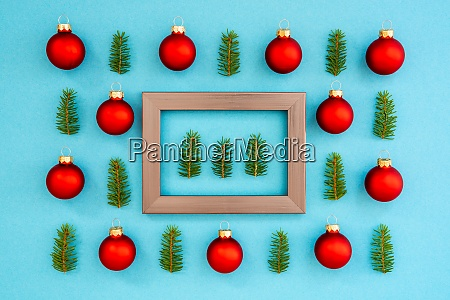 frame with three fir tree branches