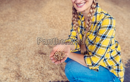 farmer woman checking on the quality
