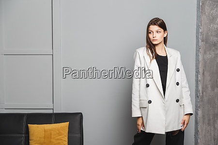young elegant woman in white oversize