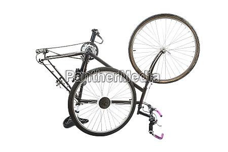 bicycle on white taken apart