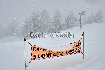 ski slop warning sign in heavy