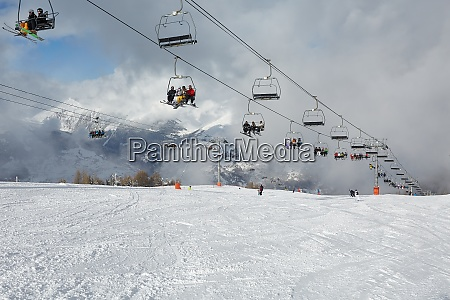 skiing slopes with many people