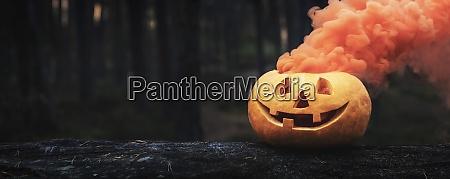 spooky halloween pumpkin with orange smoke