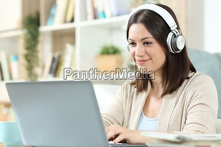 woman with headphones and laptop at
