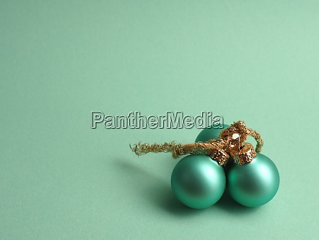 three turquoise vintage christmas baubles on