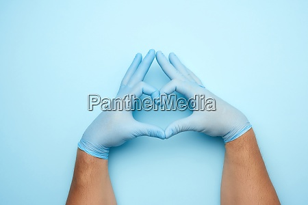 two male hands in blue latex