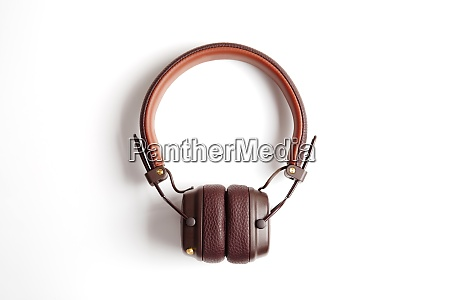 modern brown leather wireless headphones isolated