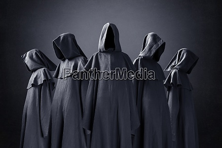 group of five scary figures in