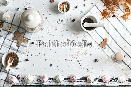 white table strewn with candy powder