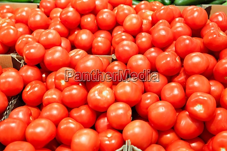 boxes with tomatoes in supermarket healthy