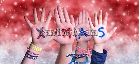 children hands building word xmas red