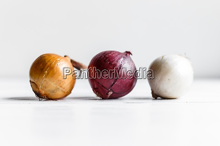 three bulbs on a white wooden