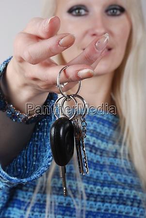 woman holding car key