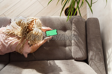 woman with blond canecalons lying on