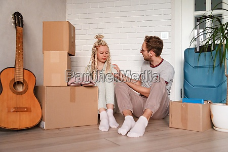 a woman is upset after moving