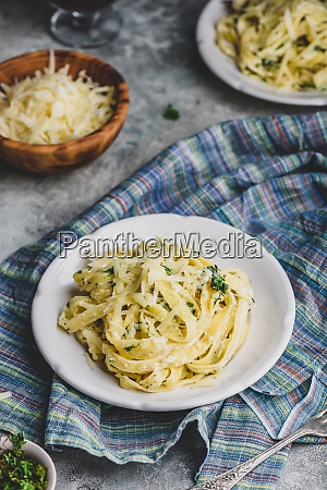 portions of fettuccine with alfredo sauce