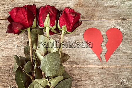 red broken heart with dry roses