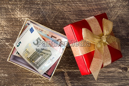 euro banknotes inside the gift box