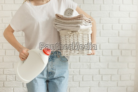 woman holding detergent gel bottle and