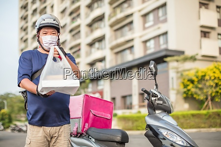 food delivery staff ride motorcycles to